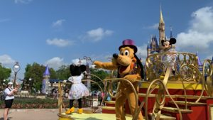 Mickey and Pals on a cavalcade vehicle