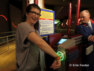 Using my MagicBand to enter the FastPass line at Soarin'. Note the screen in the center. This tells the cast member my name and other information. This may lead to less sharing of FastPasses among family members.