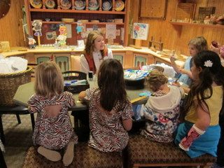 Children interacting with a cast member at the Norway Kidcot Fun Stop.