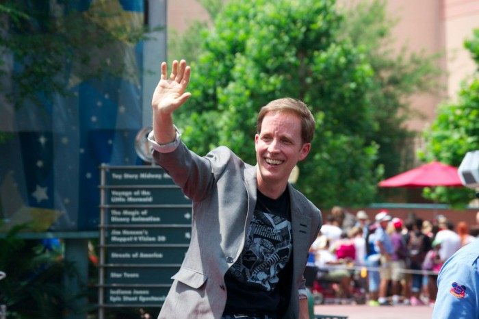 Star Wars Celebrity Host James Arnold Taylor waves to the crowd.