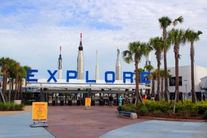 The entrance to Kennedy Space Center Visitor Complex with the Rocket Garden in the back.