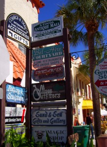 Signs showing a selection of shops in Cocoa Village.
