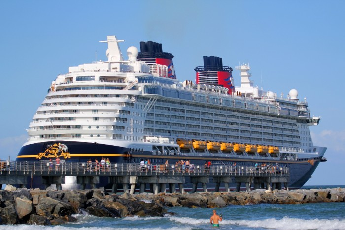 Disney's Cruise Ship Fantasy passes by the fishing pier at Jetty Park.