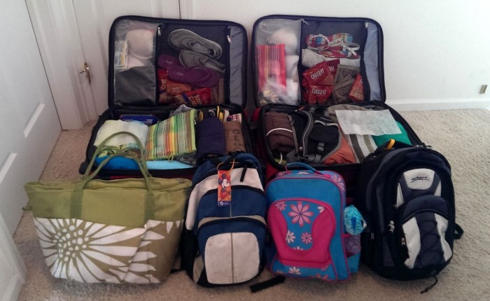 Two checked bags and four carry-ons, ready for our vacation. Perfect for my family of four.