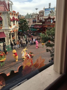 The view of a parade from Walt's Restaurant