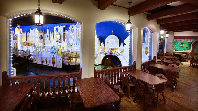 Grab a table in this popular and coveting seating area to overlook It's A Small World. Photo courtesy of Disney (c)