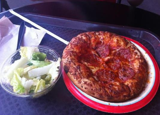 Cup-o-salad and pepperoni pizza