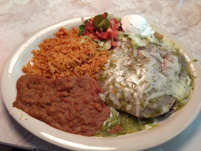 The stacked enchiladas at Chuy's come with blue corn tortilla and a fresh tomatillo sauce. (Photo by Julia Mascardo)