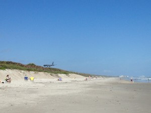 Unspoiled shoreline at Hangars Beach - complete with low-flying military plane.