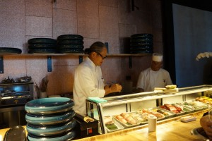 Chef Masaharu Morimoto (left) hard at work at the sushi bar. (Photo by Julia Mascardo)