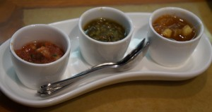 The trio of condiments: two salsas and an apple-peach chutney. Photo by Julia Mascardo