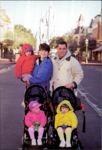 You can't see it, but there's a buggy board clipped to the back of one of those strollers. With three small kids, this was our method of choice for many years of Disney visits