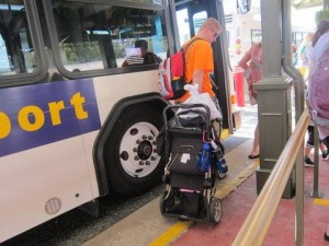 You'll have to fold your stroller to bring it onto a Disney bus