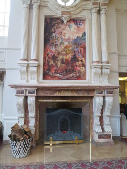 A huge mural lies above a high fireplace adjacent to the registration nook.