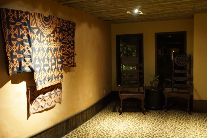 An African garment adorns a corner in one of the hallways of African Kingdom Lodge.