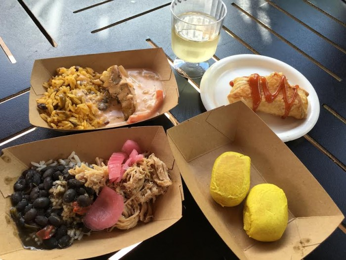 Islands of the Caribbean's Caribbean Sangria, Quesito, Jamaican Beef Patty, Mojo Pork, and Seared Grouper (clockwise from top)