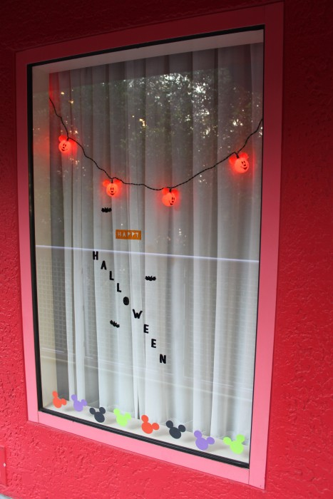 Lights, window clings, and paper mickey decorations for Halloween