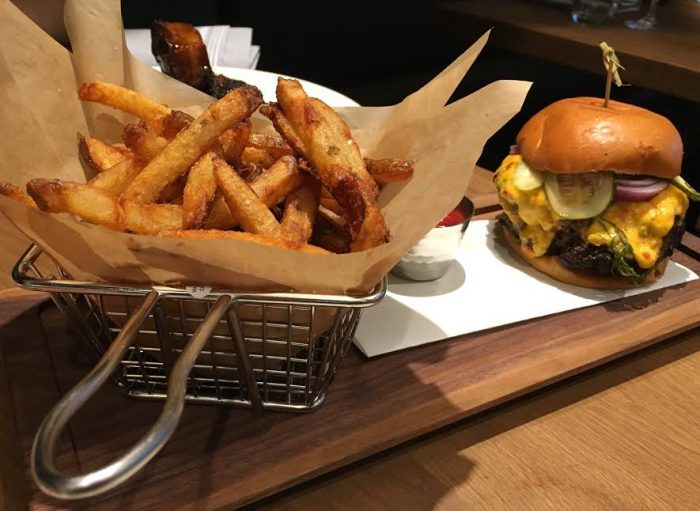 The Burger with house-made pickles and pimento cheese