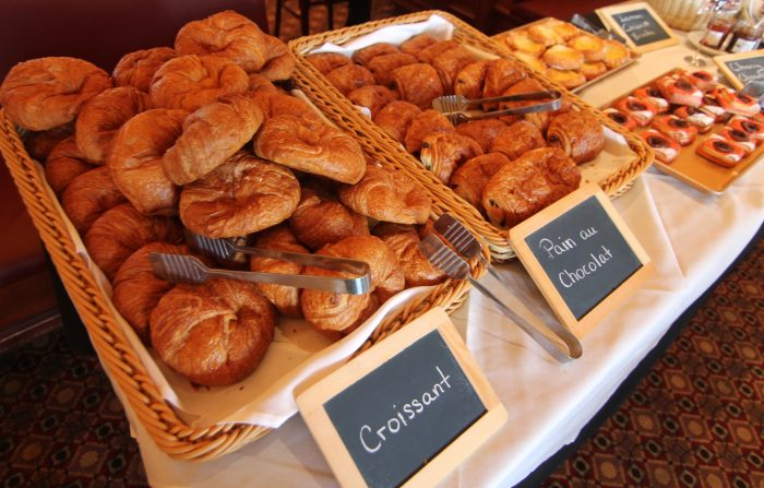 Trays of perfect croissants and pain au chocolat ready for guests to enjoy