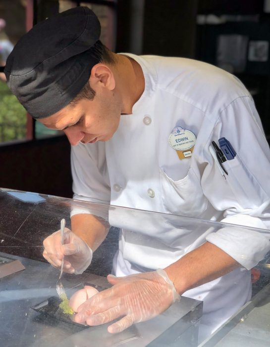 Chefs carefully craft every dish at the 2019 Epcot International Festival of the Arts